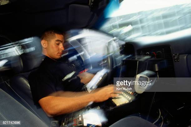 los angeles police rookie checking status of automobile - los angeles police department stock pictures, royalty-free photos & images