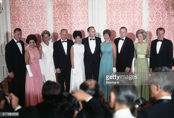 President and Mrs Nixon and VicePresident and Mrs Agnew pose with their guests of honor the Apollo 11 astronauts and their wives before the state...