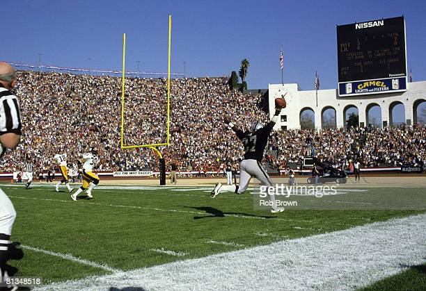 Los Angeles Raiders cornerback Lester Hayes runs with the football as he heads for the end zone to complete an 18yard interception return for a...