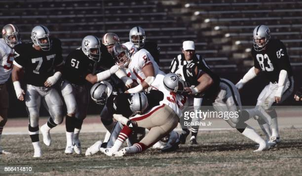 Los Angeles Raiders Lyle Alzado Howie Long and Ted Hendricks surround 49'ers running back during San Francisco vs Los Angeles Raiders game August 6...