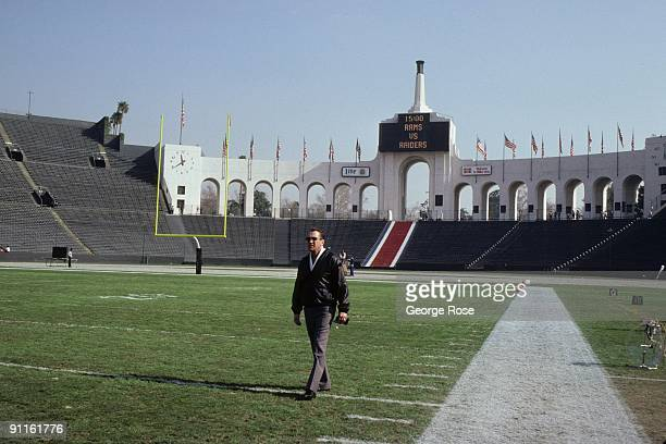 Los Angeles Raiders owner Al Davis walks on the field before the game against the St. Louis Rams at the Los Angeles Memorial Coliseum on December 18,...