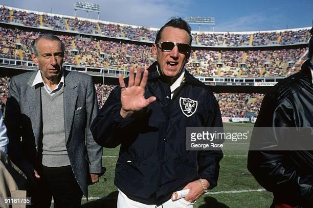 Los Angeles Raiders owner Al Davis walks on the field during the game against the Denver Broncos at Mile High Stadium on December 8 1985 in Denver...