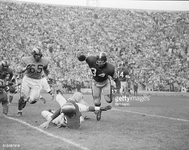 Los Angeles Ram end Bob Boyd couldn't put conventional tackle on 49er fullback Joe Perry when he was blocked by 49er Gordy Soltau so he stuck out...