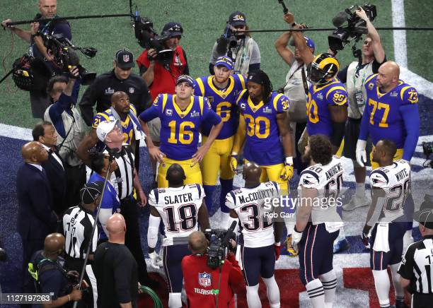 Los Angeles Rams and New England Patriots meet at mid field for the coin toss prior to Super Bowl LIII at MercedesBenz Stadium on February 03 2019 in...