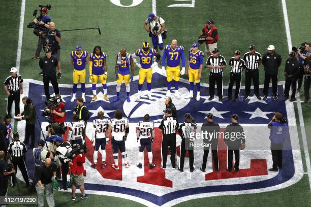 Los Angeles Rams and New England Patriots meet at mid field for the coin toss prior to Super Bowl LIII at Mercedes-Benz Stadium on February 03, 2019...