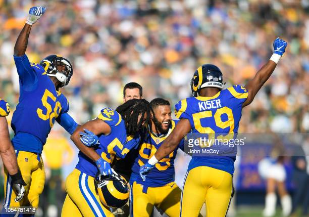 Los Angeles Rams celebrate a fumble recovery against the Green Bay Packers at Los Angeles Memorial Coliseum on October 28 2018 in Los Angeles...