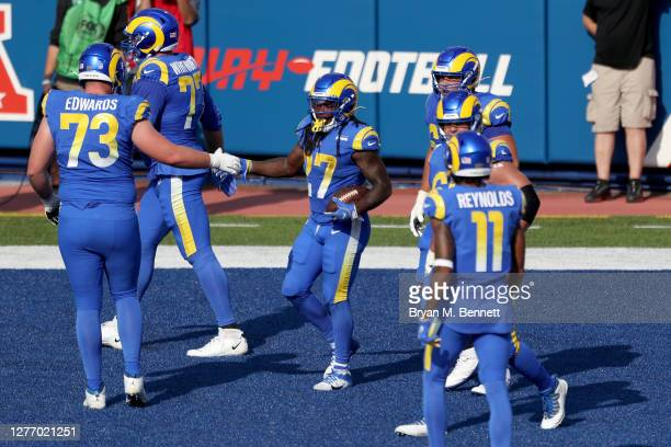 Los Angeles Rams celebrate after Darrell Henderson scored a touchdown during the fourth quarter against the Buffalo Bills at Bills Stadium on...