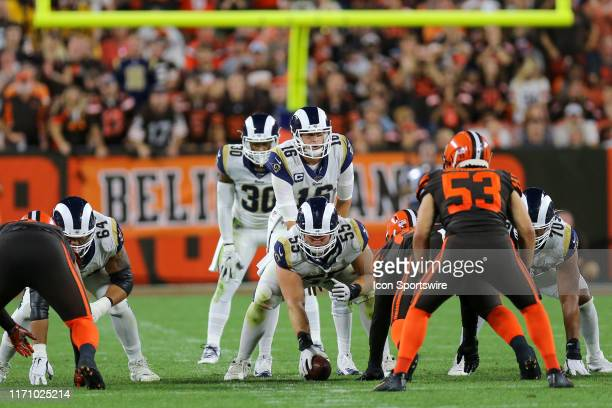 Los Angeles Rams center Brian Allen prepares to snap the ball to Los Angeles Rams quarterback Jared Goff during the fourth quarter of the the...