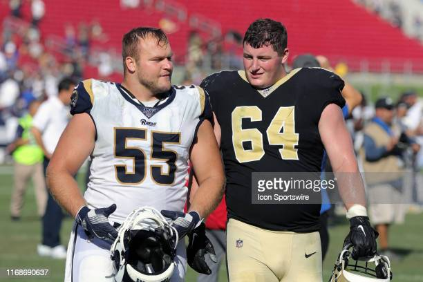 Los Angeles Rams center Brian Allen talks with New Orleans Saints center Will Clapp after the game between the Los Angeles Rams and New Orleans...