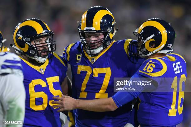 Los Angeles Rams center John Sullivan tackle Andrew Whitworth and quarterback Jared Goff at Los Angeles Memorial Coliseum on January 12 2019 in Los...