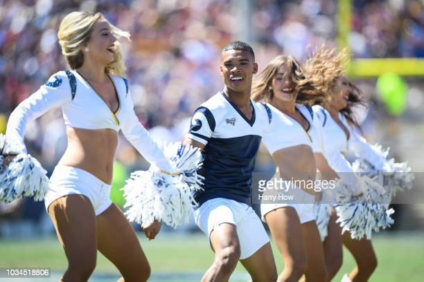 Los Angeles Rams cheerleader Napoleon Jinnies dances during the game against the Arizona Cardinals at Los Angeles Memorial Coliseum on September 16...