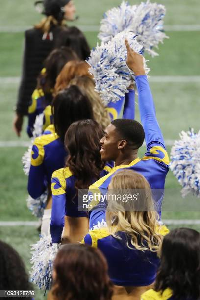 Los Angeles Rams cheerleader Quinton Peron cheers during Super Bowl LIII against the New England Patriots at MercedesBenz Stadium on February 3 2019...