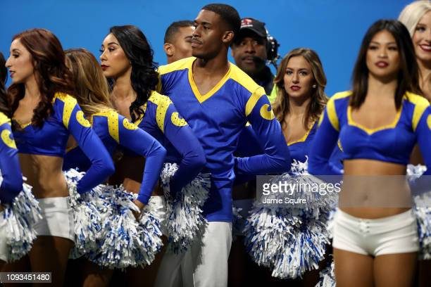 Los Angeles Rams cheerleader Quinton Peron looks on during Super Bowl LIII against the New England Patriots at MercedesBenz Stadium on February 3...