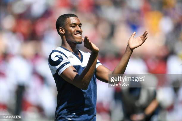 Los Angeles Rams cheerleader Quinton Peron one of the first male NFL cheerleaders cheers ahead of the game against the Arizona Cardinals at Los...