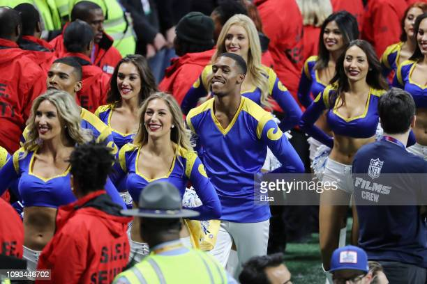 Los Angeles Rams cheerleaders Napoleon Jinnies and Quinton Peron look on during Super Bowl LIII against the New England Patriots at MercedesBenz...