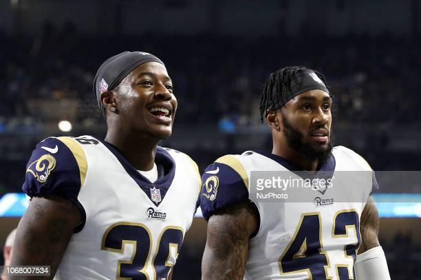 Los Angeles Rams cornerback Dominique Hatfield walks off the field flanked by Los Angeles Rams strong safety John Johnson at the end of the first...