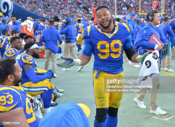 Los Angeles Rams defensive end Aaron Donald relaxes on the sidelines with his teammates in Los Angeles on Sunday, Dec. 30, 2018. The Rams beat the...