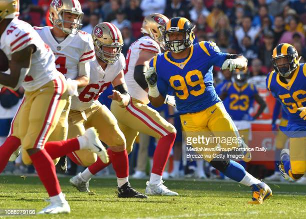 Los Angeles Rams defensive end Aaron Donald rushes the 49ers from the end in Los Angeles on Sunday, Dec. 30, 2018.