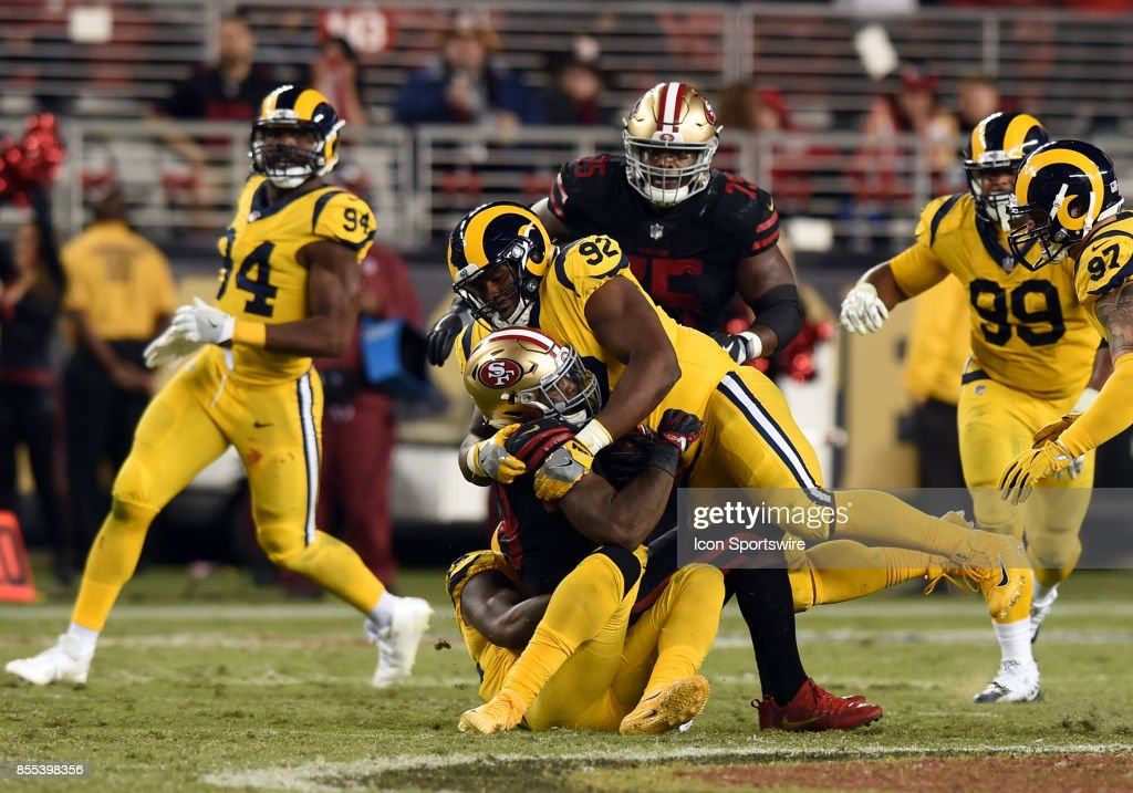 3daa21440 ... Los Angeles Rams Defensive End Tanzel Smart (92) makes a tackle during  an NFL Womens ...
