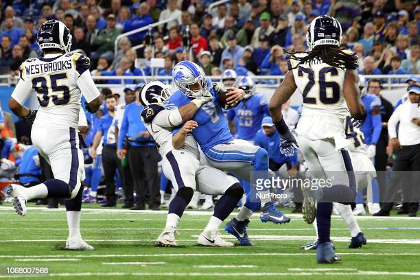Los Angeles Rams defensive tackle Aaron Donald takes down Detroit Lions quarterback Matthew Stafford during the second half of an NFL football game...