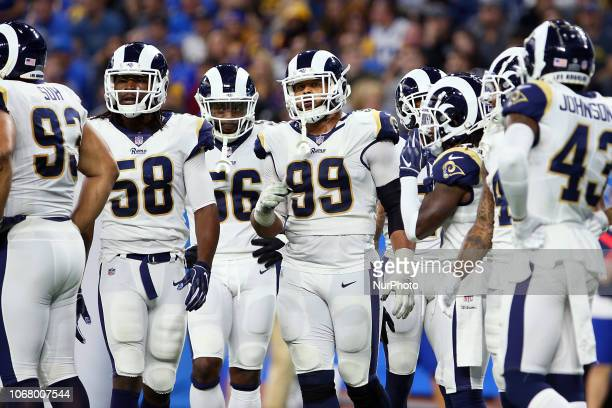 Los Angeles Rams defensive tackle Aaron Donald walks off the field after a play during the second half of an NFL football game against the Detroit...