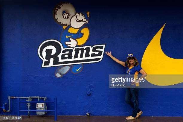 b15f0a12b383 Los Angeles Rams fan Felipa Moran Vidrio poses for a picture in front of  Randy s Donuts
