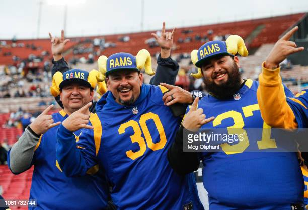 Los Angeles Rams fans pose for a photo ahead of the the NFC Divisional Round playoff game between the Los Angeles Rams and the Dallas Cowboys at Los...
