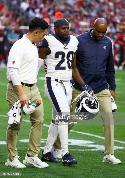 Los Angeles Rams free safety Lamarcus Joyner is assisted off the field by medical staff during the NFL football game between the Arizona Cardinals...