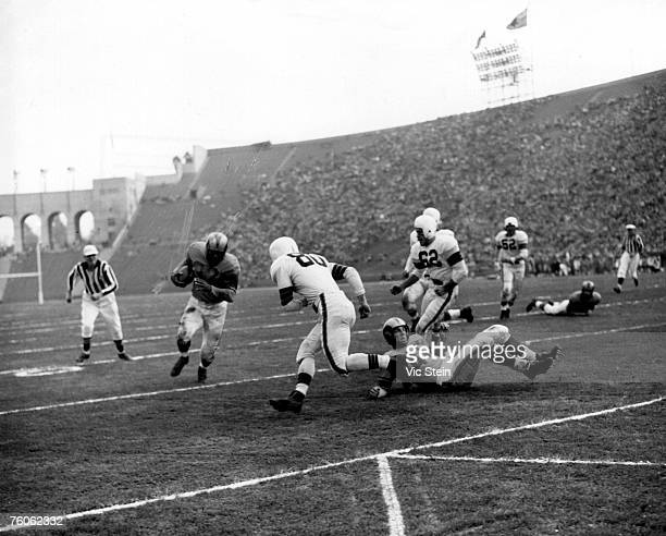 Los Angeles Rams halfback Dan Towler on a carry in a 2417 win over the Cleveland Browns in a League Championship game on December 23 1951 at Los...