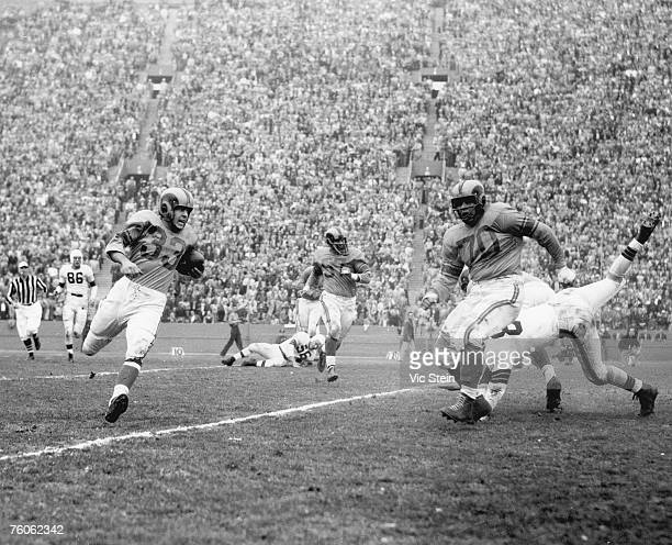 Los Angeles Rams halfback Jerry Williams carries the football during the Rams 2417 victory over the Cleveland Browns in the 1951 NFL Championship...