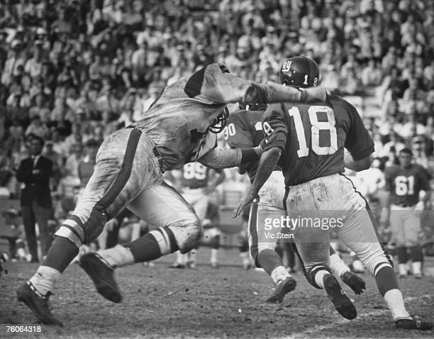 Los Angeles Rams Hall of Fame defensive end Deacon Jones chases down New York Giants quarterback Gary Lane during a 2421 Rams victory on November 24...
