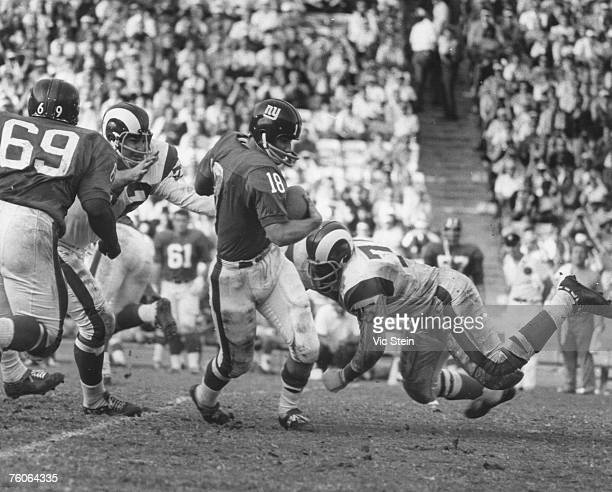 Los Angeles Rams Hall of Fame defensive end Deacon Jones dives for New York Giants quarterback Gary Lane during a 2421 Rams victory on November 24 at...