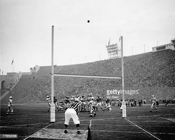 Los Angeles Rams Hall of Fame kicker Bob Waterfield makes a field goal kick in a 2417 win over the Cleveland Browns in a League Championship game on...