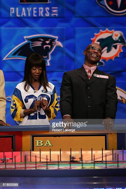 Los Angeles Rams Hall of Fame running back Eric Dickerson reacts with his favorite Rams fan during the Wheel of Fortune NFL Players Week taping on...