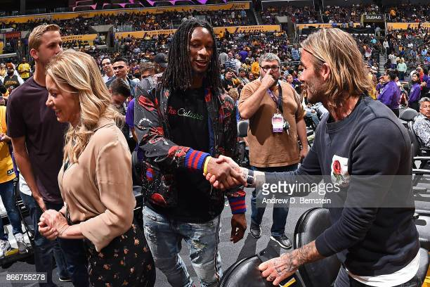 Los Angeles Rams Jared Goff and Todd Gurley greet Soccer player David Beckham and Los Angeles Lakers president Jeanie Buss after the game against the...