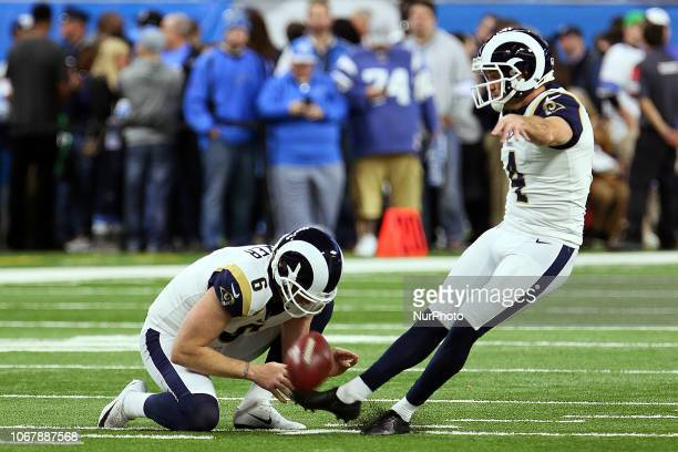 Los Angeles Rams kicker Greg Zuerlein kicks while Los Angeles Rams punter  Johnny Hekker holds the 13c5b02d7