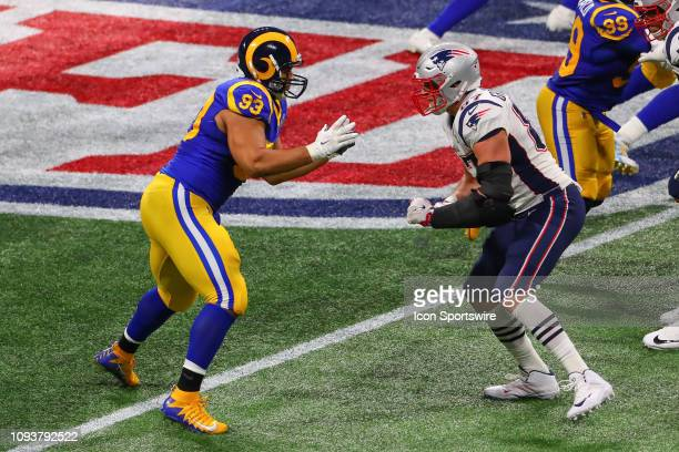 Los Angeles Rams nose tackle Ndamukong Suh battles New England Patriots tight end Rob Gronkowski during the second quarter of Super Bowl LIII between...