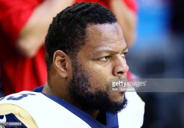 Los Angeles Rams nose tackle Ndamukong Suh sits on the sideline during the NFL football game between the Arizona Cardinals and the Los Angeles Rams...
