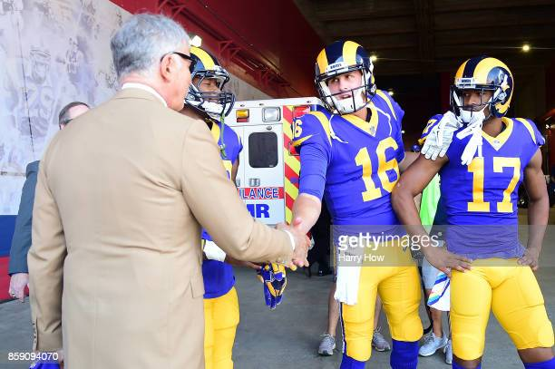 Los Angeles Rams owner Stan Kroenke of the Los Angeles Rams shakes hands with quarterback Jared Goff of Los Angeles Rams before the game against the...