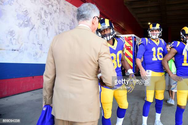 Los Angeles Rams owner Stan Kroenke shakes hands with running back Todd Gurley of Los Angeles Rams before the game against the Seattle Seahawks at...