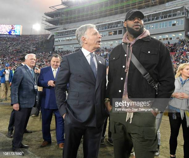Los Angeles Rams owner Stan Kroenke talks to Los Angeles Lakers star LeBron James on the sidelines before the Rams take on the Dallas Cowboys in the...
