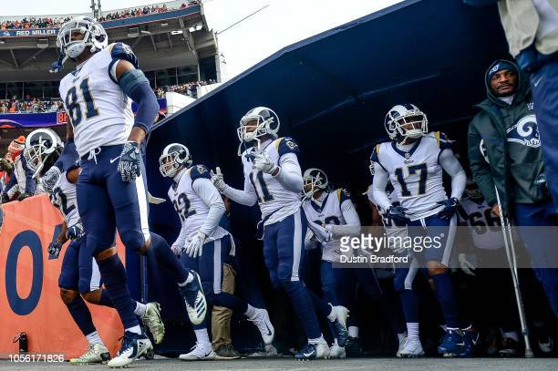 Los Angeles Rams players including tight end Gerald Everett wide receiver KhaDarel Hodge wide receiver Robert Woods and cornerback Aqib Talib walk...