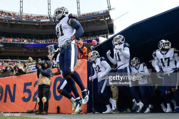 Los Angeles Rams players including tight end Gerald Everett wide receiver KhaDarel Hodge wide receiver Robert Woods walk onto the field before a game...
