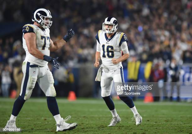 Los Angeles Rams Quarterback Jared Goff celebrates with Los Angeles Rams Offensive Tackle Andrew Whitworth after throwing a pass for a touchdown...