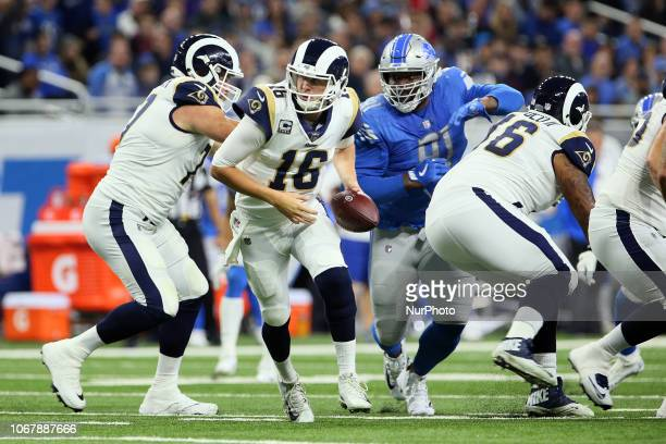Los Angeles Rams quarterback Jared Goff looks to hand off the ball during the first half of an NFL football game against the Los Angeles Rams in...
