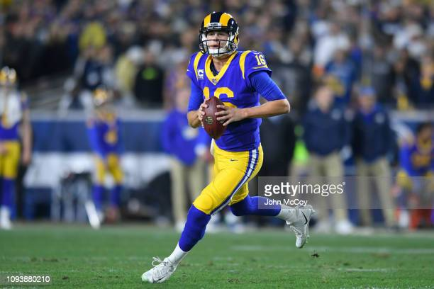 Los Angeles Rams quarterback Jared Goff runs out of the pocket looking for a receiver against the Dallas Cowboys at Los Angeles Memorial Coliseum on...