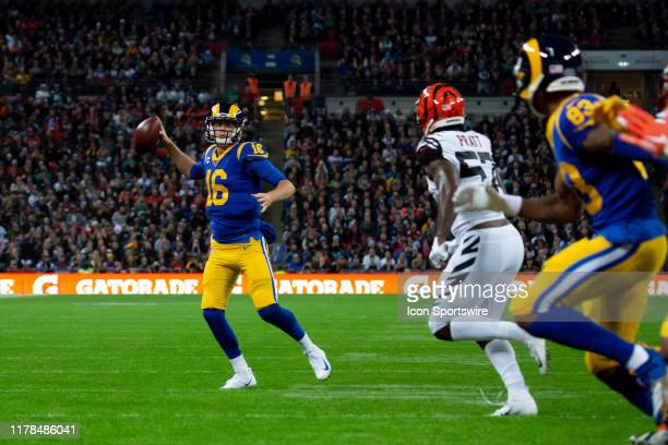 Los Angeles Rams Quarterback Jared Goff runs wide to throw for an incompletion Cincinnati Bengals Safety Jessie Bates III stretches for the ball in...