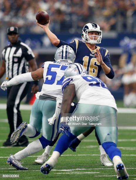 Los Angeles Rams quarterback Jared Goff throws under pressure from Dallas Cowboys outside linebacker Damien Wilson during the second half on Sunday...