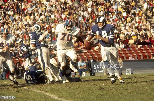 Los Angeles Rams quarterback Roman Gabriel rolls out to his left to avoid Denver Broncos defensive tackle Paul Smith in a 16-10 loss at the Los...