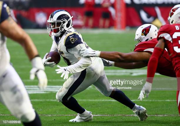 Los Angeles Rams running back CJ Anderson evades defenders during the NFL football game between the Arizona Cardinals and the Los Angeles Rams on...